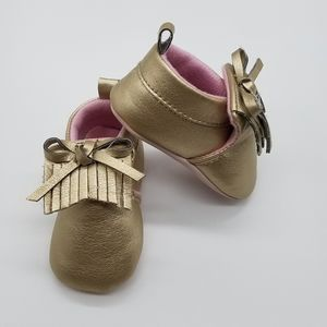 Gold and pink moccasins
